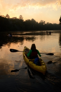 Jamie Rogers points her keyak into the sunrise as the Paddle Georgia Navy launches from Rocky Bend Flint River Retreat.